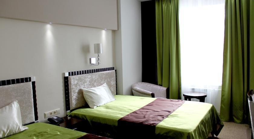 Фото номер Бизнес Отель Абникум Двухместный номер бизнес-класса с 2 отдельными кроватями