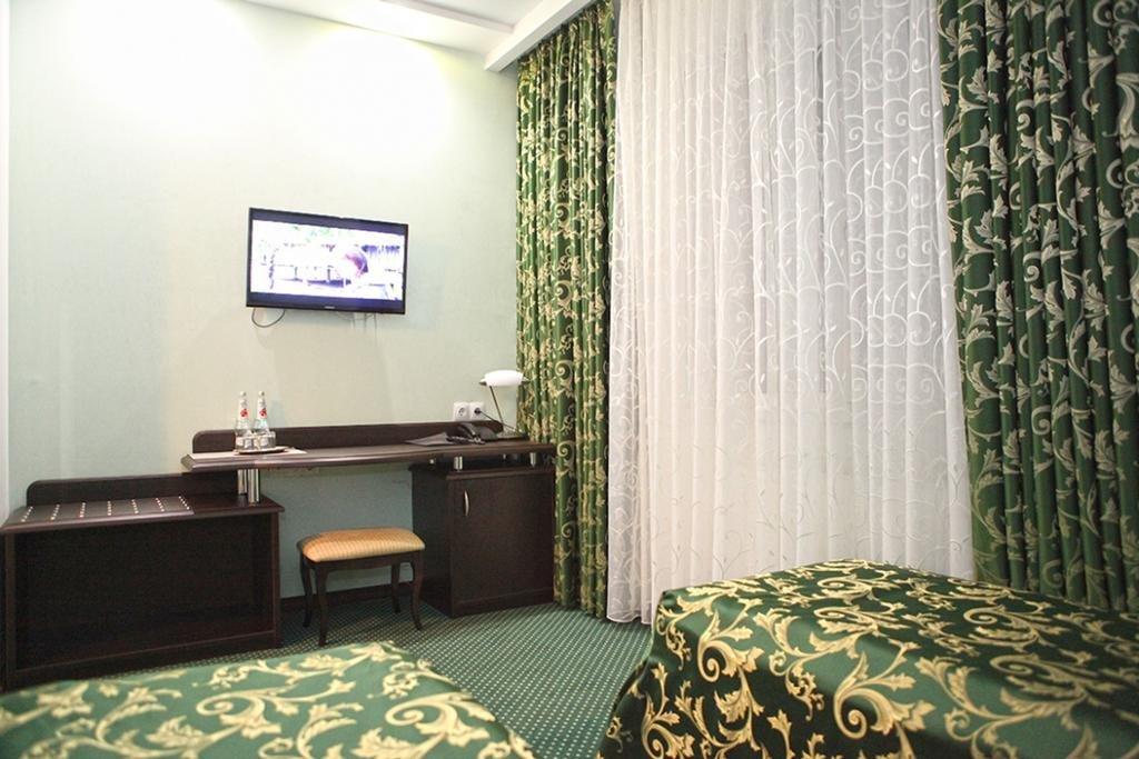 Фото номер Ринг Двухместный номер Комфорт с 2 отдельными кроватями