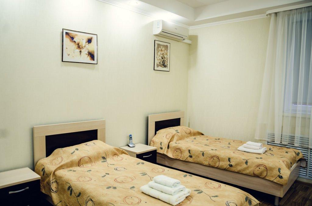 Фото номер Гостиница Олимпия Улучшенный с 2 односпальными кроватями