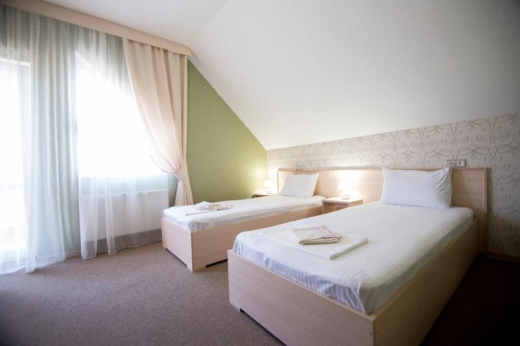 Фото номер Ламберт Двухместный номер с 2 отдельными кроватями